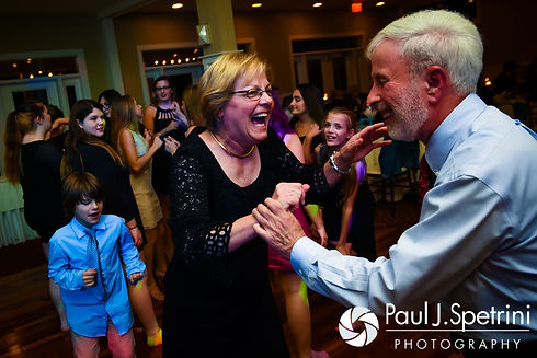 Guests dance during Kelly and Brian's November 2016 wedding reception at the Bay Pointe Club in Buzzards Bay, Massachusetts.