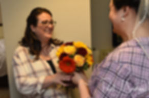 Justine gives her cousin a bouquet prior to her October 2018 wedding ceremony at Twelve Acres in Smithfield, Rhode Island.