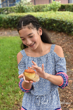 The bride's niece gets ready for a cupcake smash following Amanda & Josh's October 2018 wedding ceremony at the Walt Disney World Swan & Dolphin Resort in Lake Buena Vista, Florida.