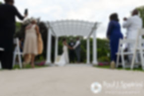 Kemi and Warren hold hands during their August 2016 wedding reception at the Villa at Riddler Country Club in East Bridgewater, Massachusetts.