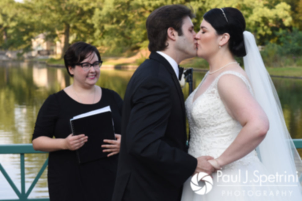 Allison and Len share their first kiss during their September 2017 wedding ceremony at the Roger Williams Park Casino in Providence, Rhode Island.