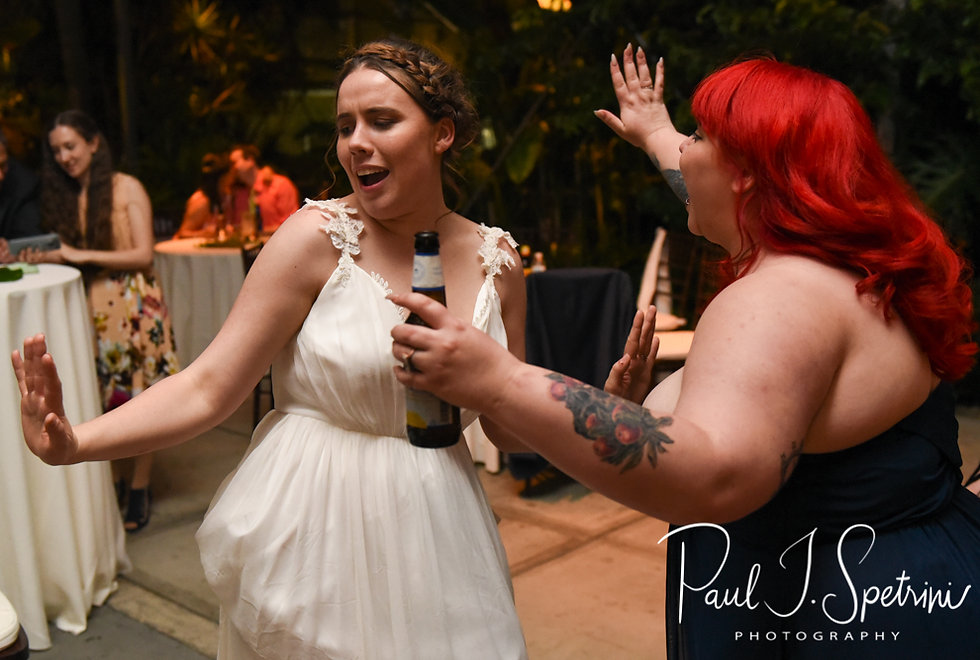 Ali dances with her maid of honor during her and Gary's May 2018 wedding reception at the Roger Williams Park Botanical Center in Providence, Rhode Island.