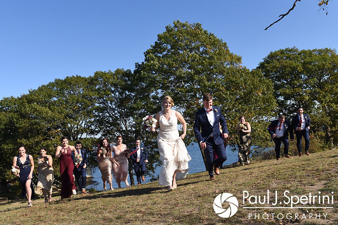 Rachel and Mike run during a photo prior to their October 2017 wedding ceremony at Castle Manor Inn in Gloucester, Massachusetts.