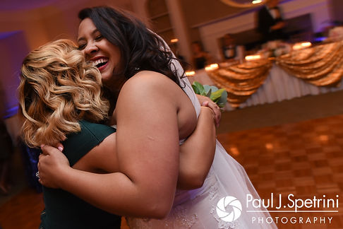 Stephany hugs a friend during her September 2017 wedding reception at Wannamoisett Country Club in Rumford, Rhode Island.