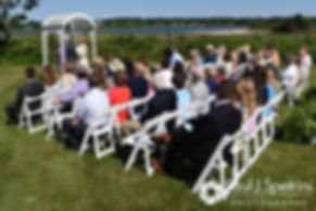 Guests watch Bob and Debbie's ceremony during their June 2016 wedding in Barrington, Rhode Island.