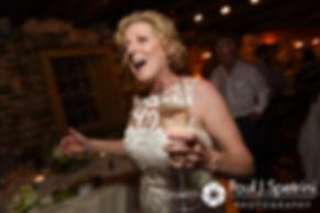 Debbie runs to the dance floor during her June 2016 wedding reception at DeWolf Tavern in Bristol, Rhode Island.
