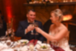 Meghan and Brian toast their glasses during their September 2018 wedding reception at Squantum Association in Riverside, Rhode Island.