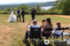 Amanda and Chris' family members look on during their summer wedding at the Quabbin Reservoir Observation Tower in Belchertown, Massachusetts on July 2nd, 2016.