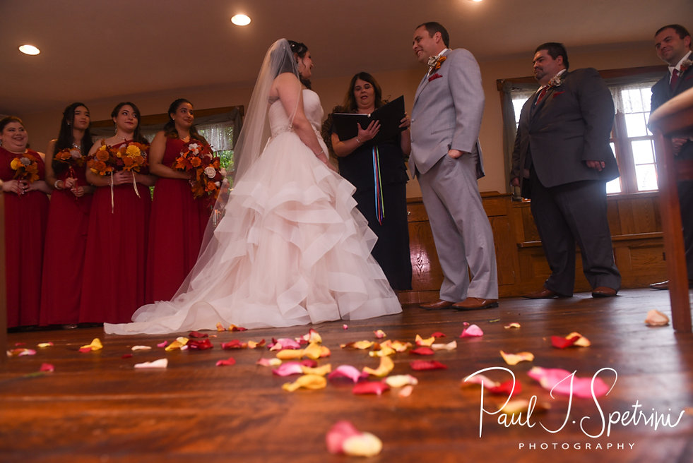 Rich and Makayla listen to their officiant during their October 2018 wedding ceremony at Zukas Hilltop Barn in Spencer, Massachusetts.