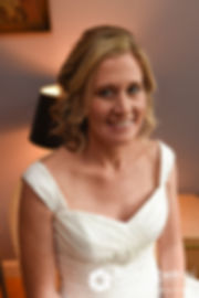 Tricia smiles for a photo prior to her October 2017 wedding ceremony at St. Brendan Parish in Riverside, Rhode Island.