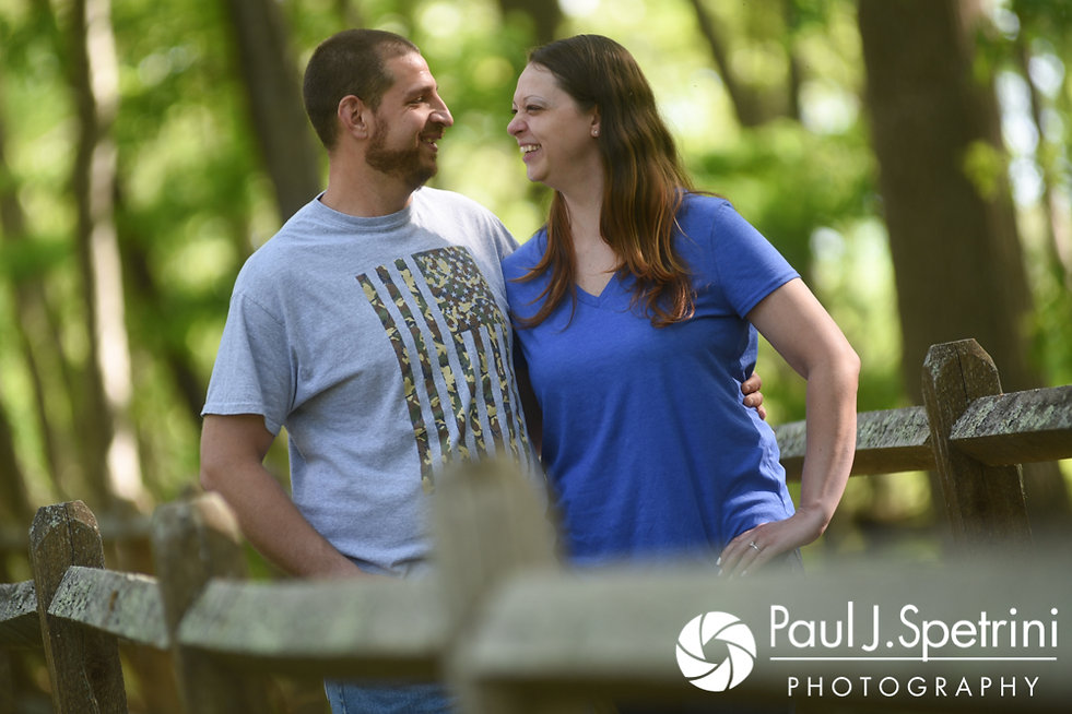 Jennifer and Kevin pose for a photo on a bridge during their May 2017 engagement session at Gillette Castle State Park in East Haddam, Connecticut.