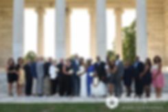 Jennifer and Mark pose for a photo with their family members during their September 2016 wedding at the Roger Williams Park Temple of Music in Providence, Rhode Island.