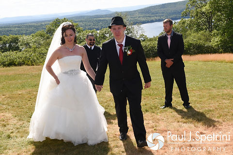 Amanda and Chris exit their summer wedding at the Quabbin Reservoir Observation Tower in Belchertown, Massachusetts on July 2nd, 2016.