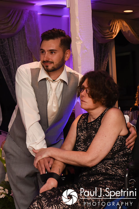 John and his mother watch a special slideshow during his September 2017 wedding reception in Warren, Rhode Island.