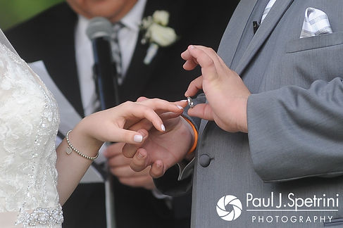 Melissa and Jordan exchange rings during their May 2017 wedding ceremony at Independence Harbor in Assonet, Massachusetts.