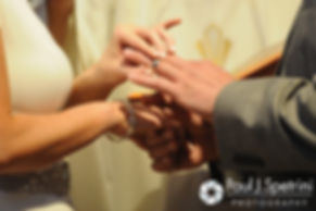 Amy and DJ exchange rings during their June 2016 wedding ceremony at St. Thomas More Church in Narragansett, Rhode Island.