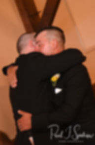 Zach hugs his best man during his June 2018 wedding reception at Blissful Meadows Golf Club in Uxbridge, Massachusetts.