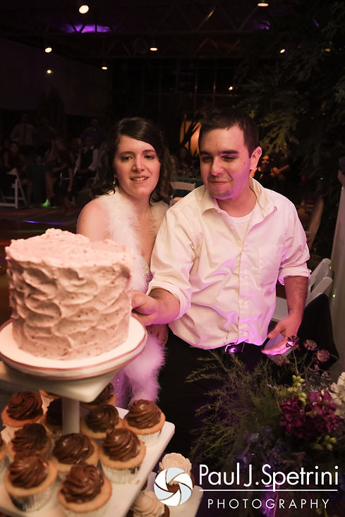 Jen and Kyle cut the cake during their September 2016 wedding reception at the Roger Williams Park Botanical Center in Providence, Rhode Island.