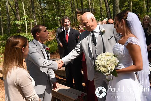 Heather's father gives his daughter away during Heather and John's July 2016 wedding ceremony at Crystal Lake Golf Club in Burrillville, Rhode Island.