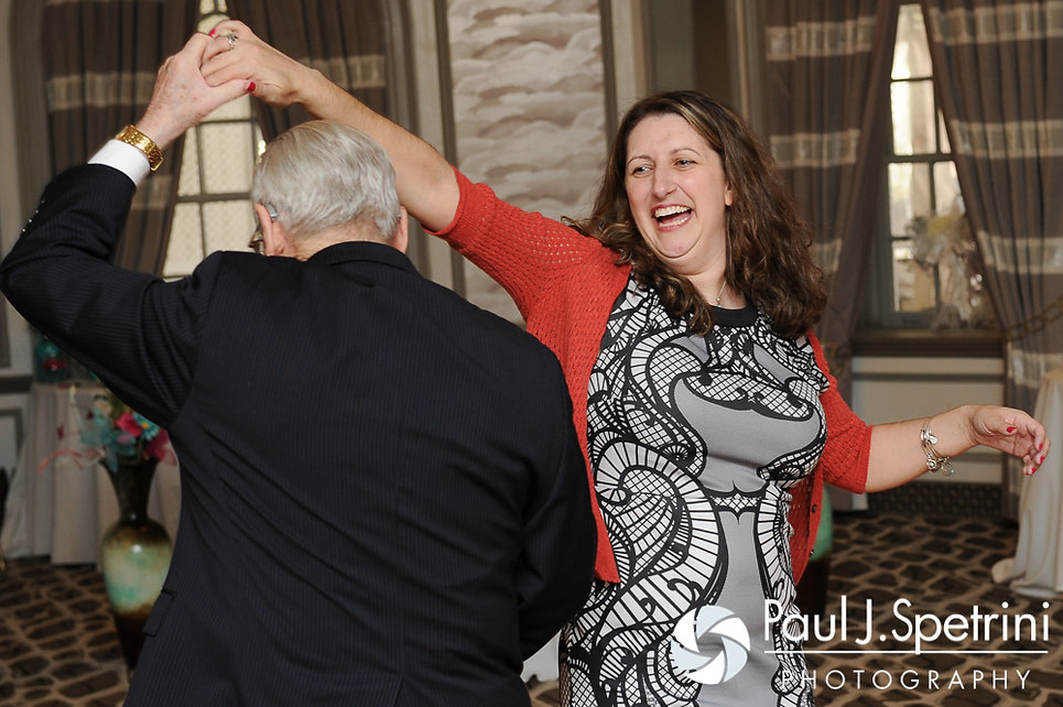 Guests dance at Angela and Shawn's spring 2016 Rhode Island wedding at the Hotel Viking in Newport, Rhode Island.