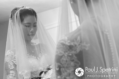 Cynthia poses for a photo in the mirror prior to her August 2017 wedding ceremony at Lake Pearl in Wrentham, Massachusetts.