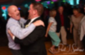 Guests dance during Patrick & Courtney's September 2018 wedding reception at Valley Country Club in Warwick, Rhode Island.