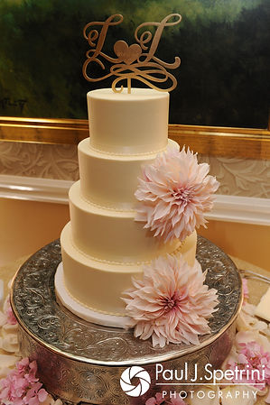 A look at Laura and Laki's wedding cake, on display during their September 2017 wedding reception at Lake of Isles Golf Club in North Stonington, Connecticut.