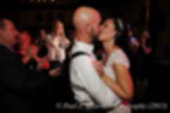 Emma and Mike kiss during their November 2015 wedding at the Publick House in Sturbridge, Massachusetts.