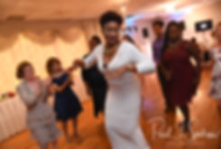 Guests dance during Courtnie and Richardson's August 2018 wedding reception at Emerald Hall in Abington, Massachusetts.