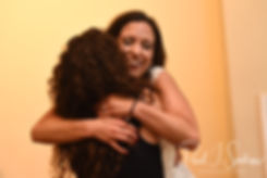 Amanda hugs a friend following a Zumba flash mob during her October 2018 wedding reception at Loon Pond Lodge in Lakeville, Massachusetts.