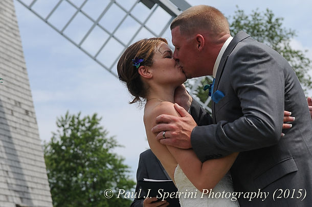 Justin and Jamie Bolani kiss at the end of their wedding ceremony, held at Prescott Farm in Portsmouth, Rhode Island in June, 2015.