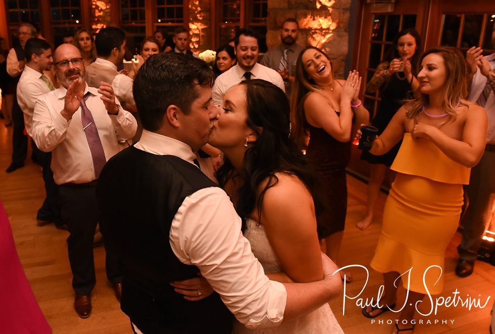 Nicole & Dan kiss during their September 2018 wedding reception at The Towers in Narragansett, Rhode Island.