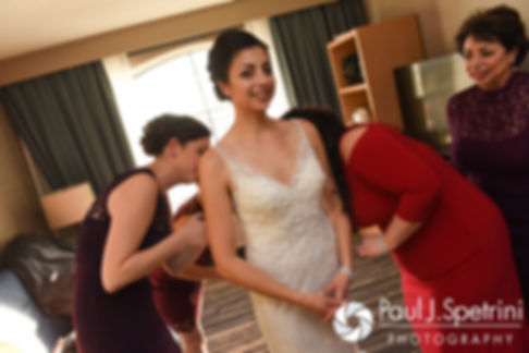 Gina has her dress zipper up prior to her December 2016 wedding ceremony at the Waterman Grille in Providence, Rhode Island.