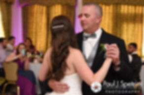 Alyssa dances with her father during her August 2016 wedding reception at LeBaron Hills Country Club in Lakeville, Massachusetts.