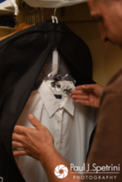 Kevin takes out his suit prior to his September 2017 wedding ceremony at Allen Hill Farm in Brooklyn, Connecticut.