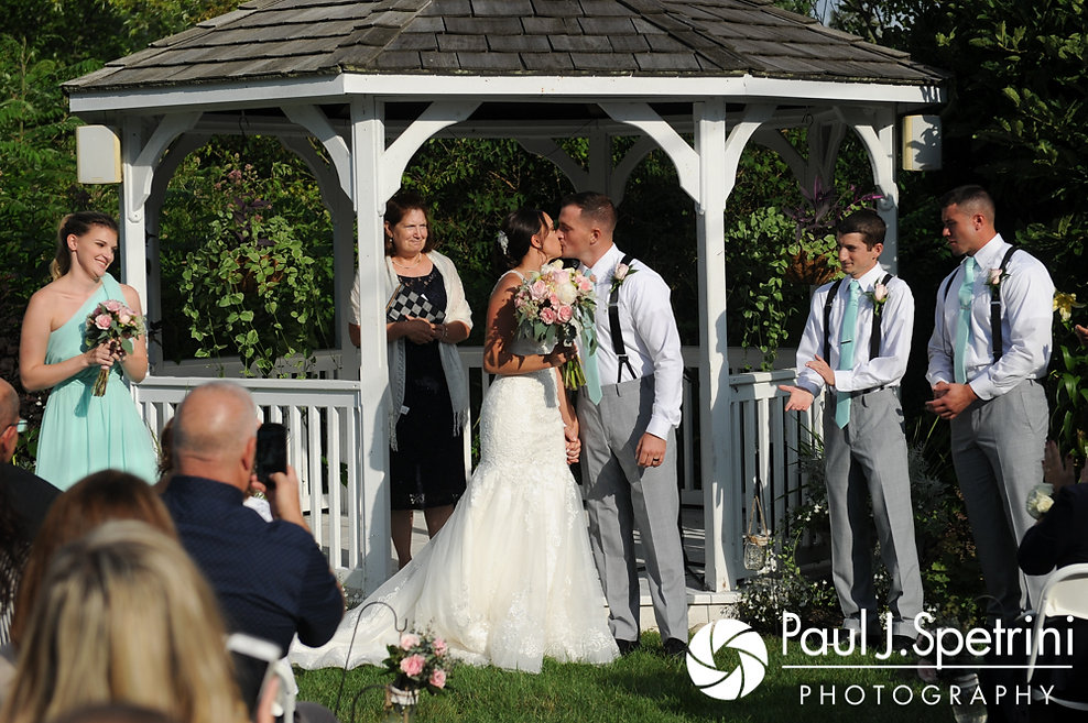 Sean and Cassie kiss during their July 2017 wedding ceremony at Rachel's Lakeside in Dartmouth, Massachusetts.