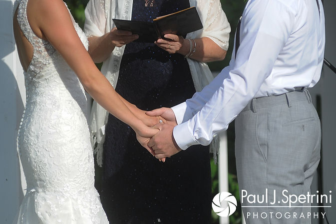 Sean and Cassie hold hands during their July 2017 wedding ceremony at Rachel's Lakeside in Dartmouth, Massachusetts.