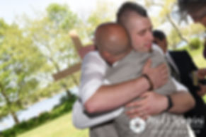 Ian hugs a groomsmen following his May 2016 wedding at Colt State Park in Bristol, Rhode Island.