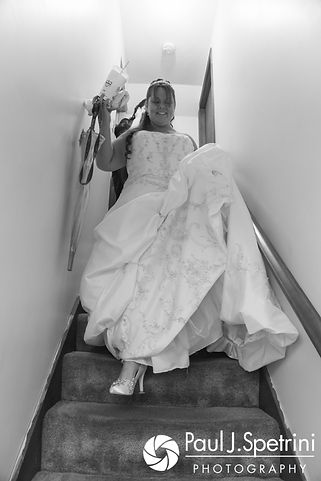 Clarissa walks down the stairs and leaves her home prior to her June 2017 wedding ceremony at Twelve Acres in Smithfield, Rhode Island.