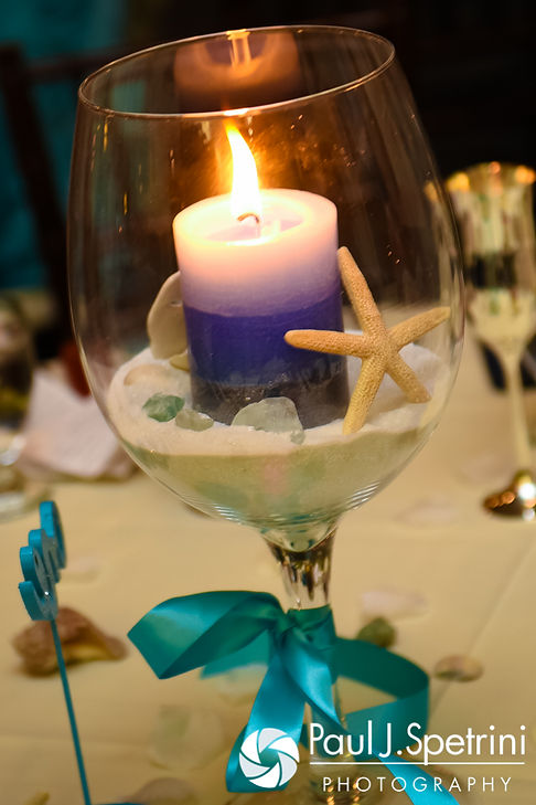 A look at the centerpiece of the sweetheart table, on display during Kelly and Brian's November 2016 wedding reception at the Bay Pointe Club in Buzzards Bay, Massachusetts.