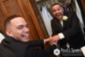 Henry jokes with his best man prior to his October 2016 wedding ceremony at the Historic St. Joseph Church in Cumberland, Rhode Island.