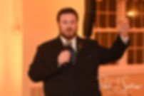 The best man gives a speech during Chris & Stephanni's October 2018 wedding reception at Rachel's Lakeside in Dartmouth, Massachusetts.