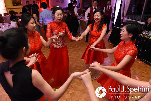 Cynthia and her bridesmaids dance during her August 2017 wedding reception at Lake Pearl in Wrentham, Massachusetts.