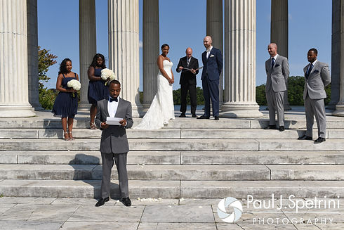 Jennifer and Mark listen to a speech by Jennifer's brother during their September 2016 wedding at the Roger Williams Park Temple of Music in Providence, Rhode Island.