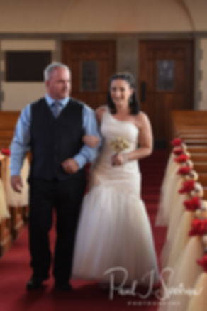 Courtnie walks down the aisle during her August 2018 wedding ceremony at Glad Tidings Church in Quincy, Massachusetts.