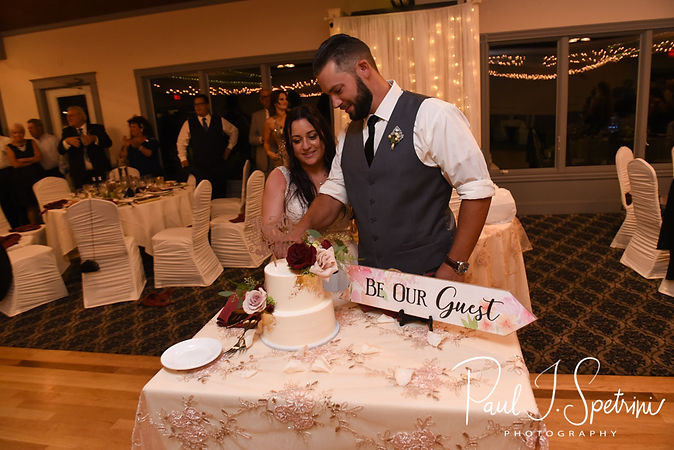 Lizzy & Gabe cut their wedding cake during their September 2018 wedding reception at Crystal Lake Golf Club in Mapleville, Rhode Island.
