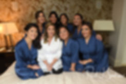 Sarah poses for a photo with her bridesmaids during her bridal prep session at The Omni Hotel in Providence, Rhode Island prior to her October 2018 wedding.