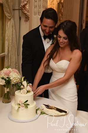 Helen and Mike cut their wedding cake during their September 2018 wedding reception at the Rosecliff Mansion in Newport, Rhode Island.