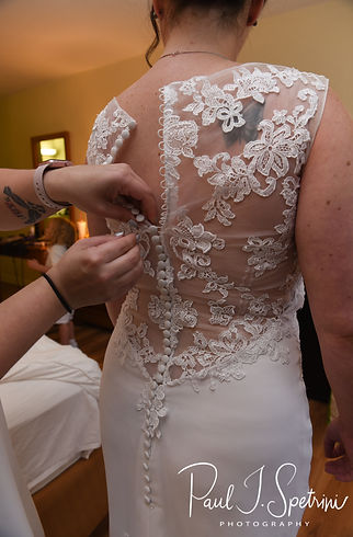 Selah has her dress zipped prior to her August 2018 wedding ceremony at The Rotunda Ballroom at Easton's Beach in Newport, Rhode Island.