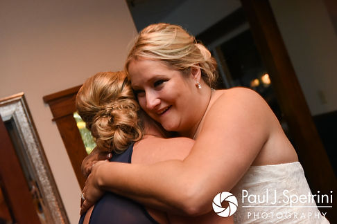 Jennifer hugs her sister during her September 2017 wedding reception at Oceanside at the Pier in Narragansett, Rhode Island.